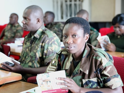 Malawi Defence Force medical personnel in DIMO's operational preventive medicine (OPM) course were given copies of a communicable disease manual as a reference on infectious diseases and epidemiology.  The OPM course assists medical personnel and commanders protect the health and strength of their military forces in deployed situations through use of critical preventive medicine measures; Lilongwe, Malawi, June 2010.  (US Air Force Photo)