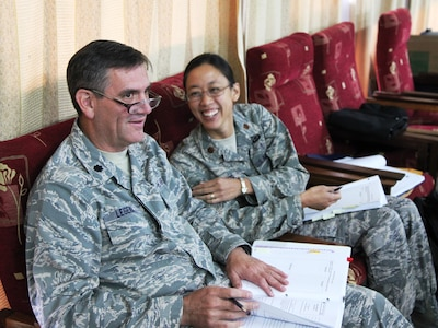 Lieutenant Colonel Paul Legendre and Maj Claudine Ward prepare for their briefings during the Defense Institute for Medical Operations (DIMO) operational preventive medicine course, presented in Lilongwe, Malawi, June 2010.  (US Air Force Photo)