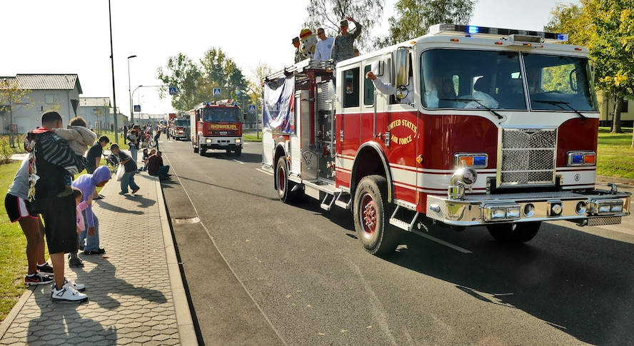 SPANGDAHLEM AIR BASE, Germany – A fire brigade of German and U.S. fire trucks pass through Spangdahlem's housing loop as part of Fire Prevention Week Oct. 9.  The day also included fire emergency services activities such as an auto extrication demonstration, U.S. and German fire truck static displays, hose bowling, bunker drills, a smoke house, stove safety and a free barbecue. Since 1922, Fire Prevention Week has taken place in the U.S. to increase fire safety awareness. (U.S. Air Force photo/Senior Airman Nick Wilson)