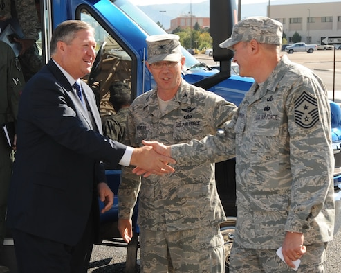 "Secretary of the Air Force Michael Donley is greeted by Col. Robert Maness, the 377th Air Base Wing commander, and Chief Master Sgt. Lee Thompson, the 377th ABW command chief, Oct. 14, 2010, as he arrives for an ""All Call"" at the Kirtland Air Force Base, N.M., base theater.  (U.S. Air Force photo)"