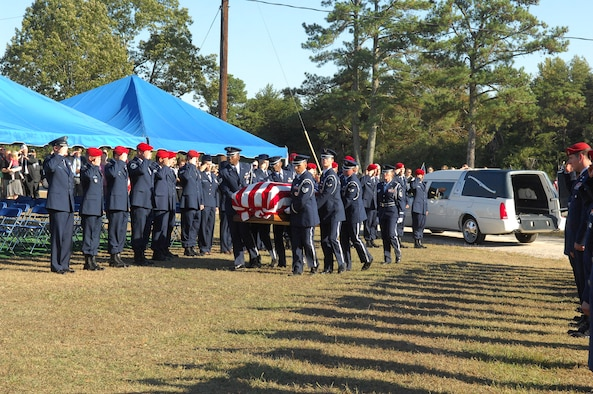 Airmen salute Senior Airman Mark A. Forester as he is laid to rest in Haleyville, Ala.  Airman Forester was killed Sept. 29 during combat operations in Uruzgan Province, Afghanistan. (U.S. Air Force photo by Senior Airman Kristopher T. Levasseur/43rd Airlift Wing Public Affairs)