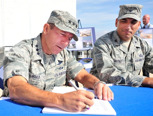 Lt. Gen. Mike Gould signs an environmental assessment and finding of no significant impact for construction of a new Center for Character and Leadership Development facility on the Honor Court of the Air Force Academy Oct. 6. The honor court is the future site of construction for the CCLD facility, which will house as many as 65 annual presentations. General Gould is the Academy superintendent; also pictured is 10th Air Base Wing Commander Col. Rick LoCastro, who also signed the FONSI. (U.S. Air Force photo/Bill Evans)