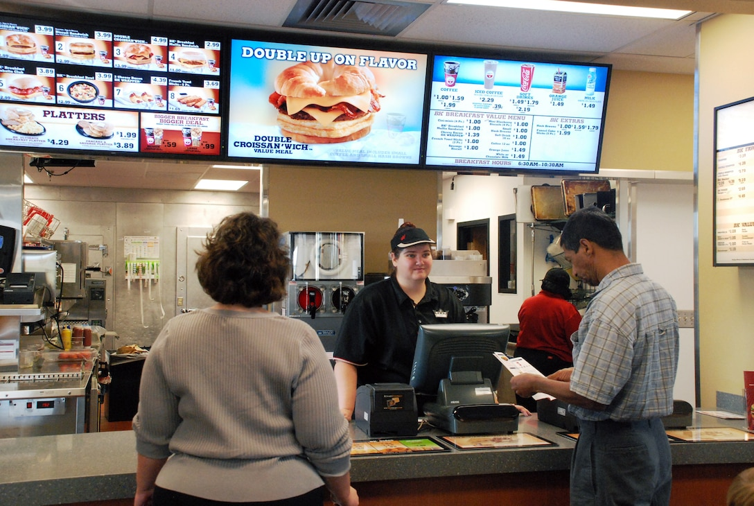 Shoppers enjoy ordering from the newly renovated Burger King on base during the grand reopening Tuesday here at F.  E. Warren Air Force Base. The eatery has been newly renovated with over $870,000 worth of upgrades.  