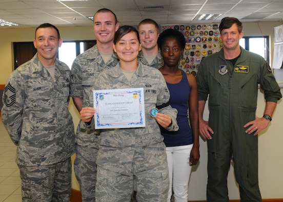 Airman 1st Class Jamaira Centeno, 36th Operations Support Squadron, Airfield Management operations coordinator poses for a photo with her coworkers after being awarded Andersen's Best, Oct. 12 at Andersen Air Force Base, Guam.(U.S. Air Force photo/ Senior Airman Nichelle Anderson)