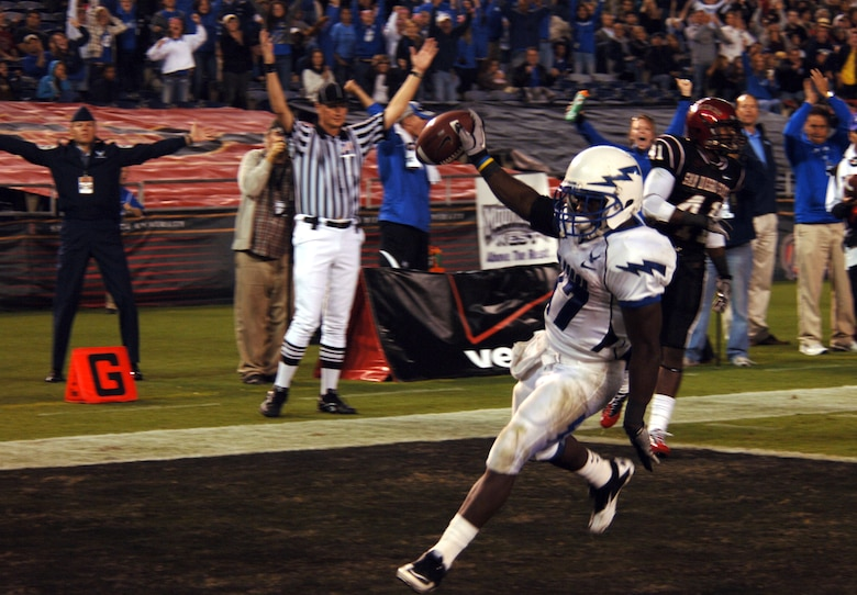 Air Force Running back Asher Clark goes in for the touchdown following a 20-yard run Saturday, Oct. 16, 2010 at San Diego's Qualcomm Stadium.  Clark recorded his second straight 100-yard game with 116 yards on 19 carries.  The Falcons lost the game 27-25 to the Aztecs of San Diego State.  (U.S. Air Force photo/Staff Sgt. Raymond Hoy)
