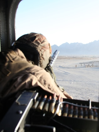 Staff Sgt. Christopher Pischl, a crew chief with Marine Heavy Helicopter Squadron 362, 3rd Marine Aircraft Wing (Forward), watches out the window of a CH-53D Sea Stallion as it lands here Oct. 17.  In support of Operation Stargey, HMH-362 transported Afghan National Army troops and coalition forces to a village between Now Zad and Musa Quelah to set up snap vehicle check points in an effort to disrupt insurgent operations in the area.  Using helicopters to insert the troops allows for surprise, flexibility and a multi-prong approach to the operation.