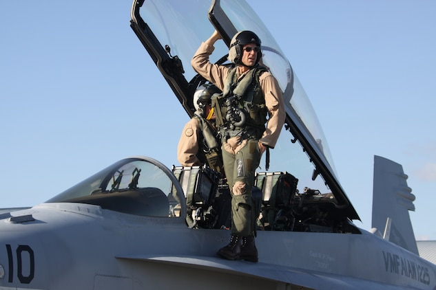 Maj. Timothy Cooper, pilot with Marine All-Weather Fighter Attack Squadron 225, boards an F/A-18 Hornet in preparation for an air-toair exercise with the Japan Air Self-Defense Force during a bilateral exercise here Oct. 19. The weeklong exercise was an opportunity for Japanese and U.S. forces to improve operational effectiveness and continue to break down communication barriers.