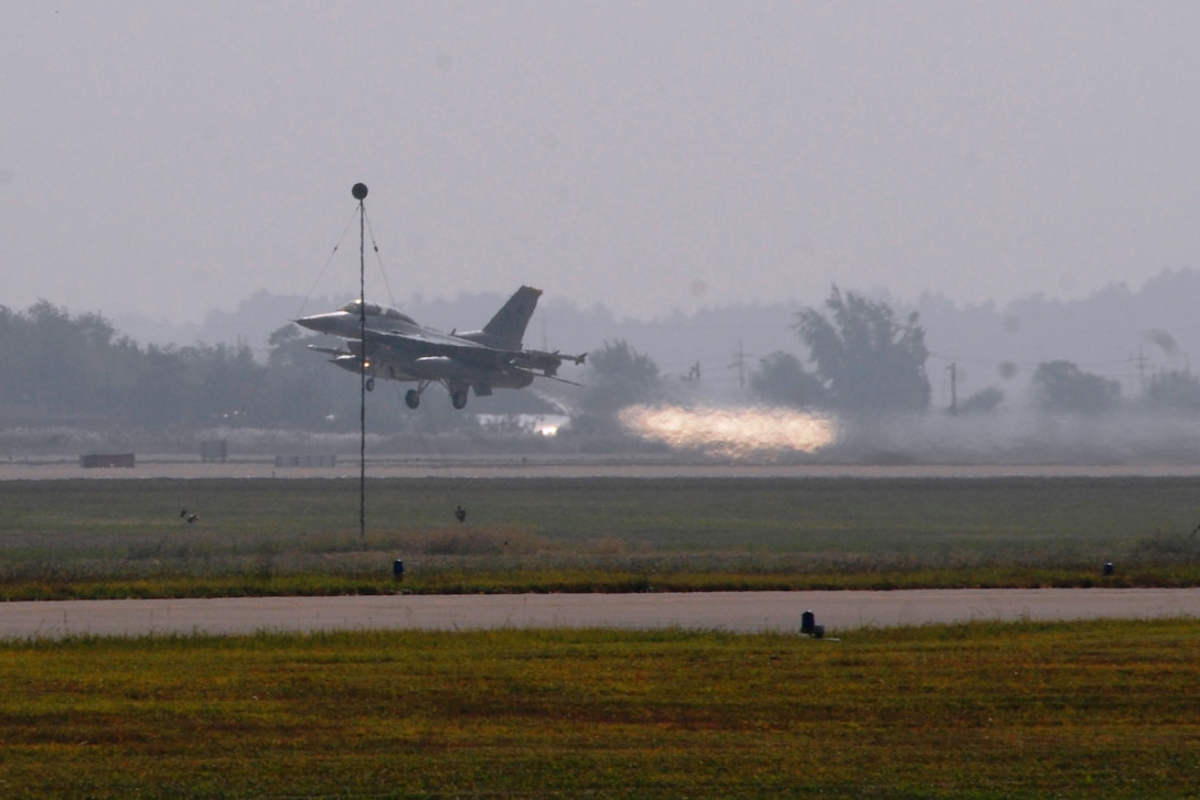 An F-16 Fighting Falcon aircraft from Kunsan Air Base, Republic of Korea, takes off during exercise Max Thunder 10-02 Oct. 18 at Kwangju Air Base, Republic of Korea. (U.S. Air Force photo/Staff Sgt. Eric Burks)