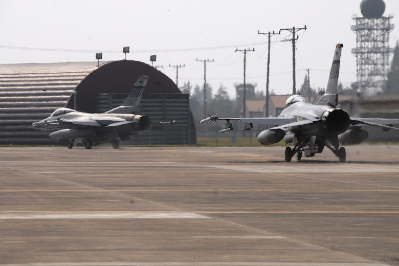 F-16 Fighting Falcon aircraft from the 36th Fighter Squadron, Osan Air Base, Republic of Korea, taxi to the runway Oct. 18 during exercise Max Thunder 10-02 at Kwangju Air Base, Republic of Korea. (U.S. Air Force photo/Staff Sgt. Eric Burks)