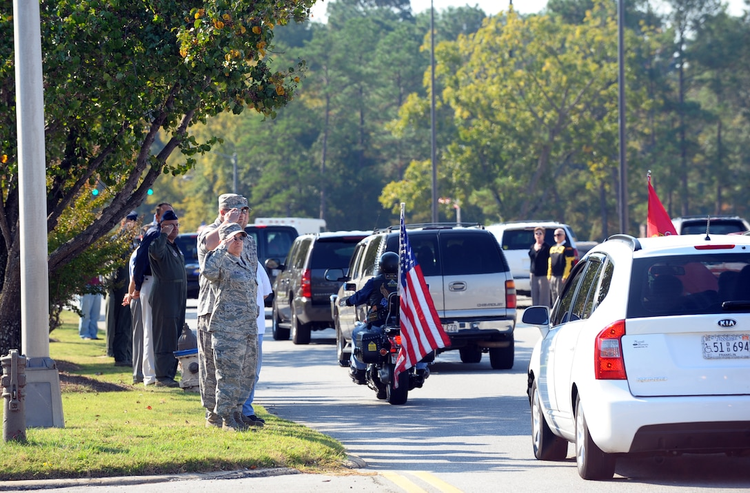 "Robins workers pay tribute to Corporal Stephen ""Coty"" Sockalosky along Robins Parkway. Cpl. Sockalosky was killed in action on Oct. 6 while supporting combat operations in Afghanistan. U. S. Air Force photo by Raymond Crayton, Jr."