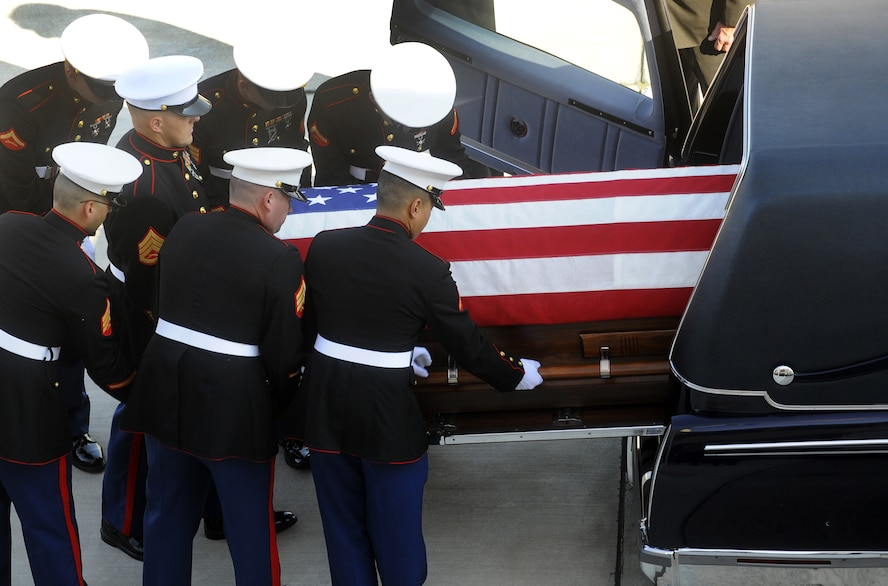 """A United States Marine Corps honor guard transfers  Corporal Stephen """"Coty"""" Sockalosky from an aircraft to an awaiting hearse at Robins Oct. 13. Cpl. Sockalosky was killed in action on Oct. 6 while supporting combat operations in Afghanistan. U. S. Air Force photo by Sue Sapp"""