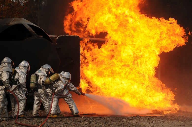 U.S. Air Force firefighters from the 180th Fighter Wing, extinguish an aircraft fire during a training exercise at the Phelps Collins Combat Readiness Training Center, Alpena, Michigan, October 16, 2010.  Firefighters from the 180 FW are doing annual training to prepare them for various rescue situations. (U.S. Air Force photo by Senior Airman Amber Williams/Released)