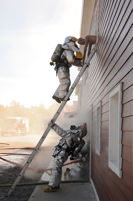 U.S. Air Force firefighters from the 180th Fighter Wing, rescue simulated victims from a burning building during a training exercise at the Phelps Collins Combat Readiness Training Center, Alpena, Michigan, October 16, 2010.  Firefighters from the 180 FW are doing annual training to prepare them for various rescue situations. (U.S. Air Force photo by Senior Airman Amber Williams/Released)