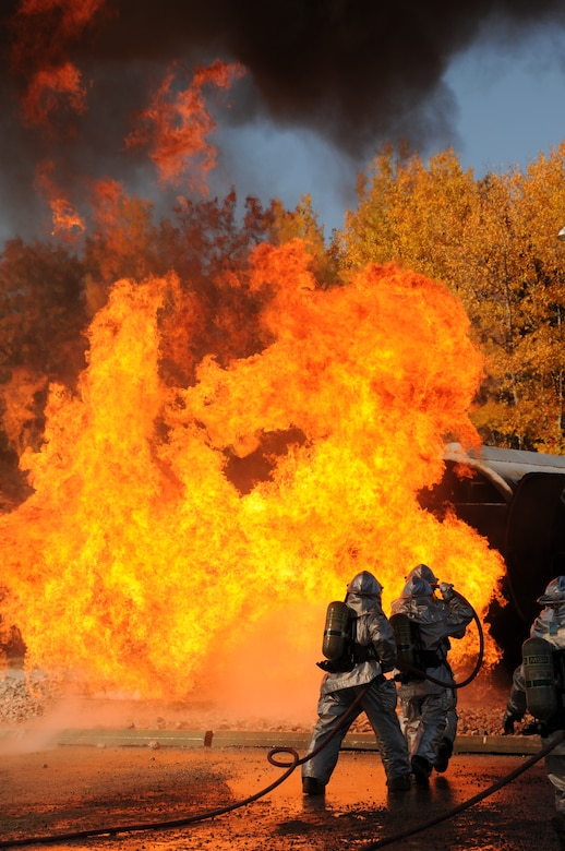 U.S. Air Force firefighters from the 180th Fighter Wing, extinguish an aircraft fire during a training exercise at the Phelps Collins Combat Readiness Training Center, Alpena, Michigan, October 15, 2010.  Firefighters from the 180 FW are doing annual training to prepare them for various rescue situations. (U.S. Air Force photo by Senior Airman Amber Williams/Released)