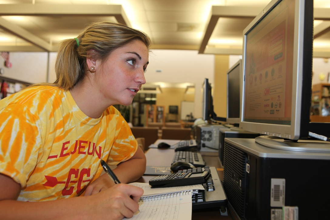 Tayler Snipes, a senior at Lejeune High School, uses Tutor.com to get help with her calculus homework at LHS aboard Marine Corps Base Camp Lejeune, recently.  Military dependents in grades kindergarten through 12th grade and service members enrolled in community colleges are logging onto Tutor.com to get some extra help from professional tutors so they can excel in their studies.