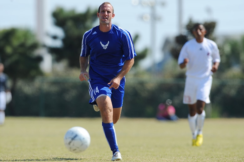 U.S. Air Force Capt. Jason Park, assigned to General Mitchell Field, Wis., a member of the USAF soccer team, dribbles the ball during an Armed Forces Men's Soccer Championship Round Robin match against the U.S. Marine Corps at Morgan Sports Complex, Destin, Fla., Oct. 18, 2010. (DoD photo by U.S. Air Force Senior Airman Sheila deVera/RELEASED)
