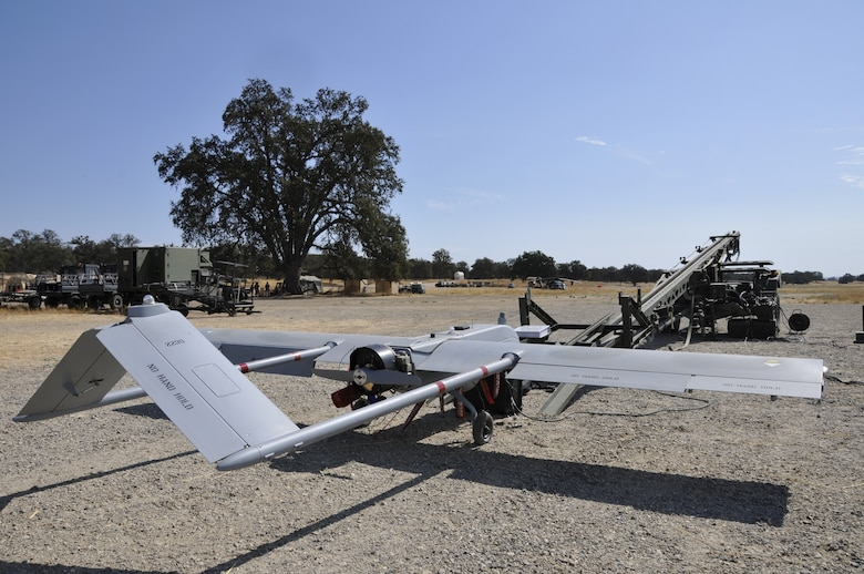 An unmanned aerial vehicle from the California Army National Guard sits before take-off during the 129th Rescue Wing's Soaring Angel exercise at Fort Hunter Liggett, Calif., Oct. 1, 2010. The tactical unmanned aerial system asset is being used to enhance situational awareness and terminal area survivability during personnel recovery scenarios. Soaring Angel is the 129th Rescue Wing's tactical training exercise that prepares Airmen for an upcoming Operational Readiness Inspection. (Air National Guard photo by Master Sgt. Dan Kacir)