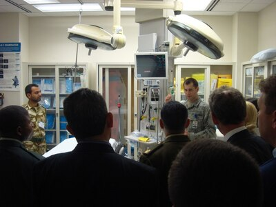 The Defense Institute for Medical Operations (DIMO) Executive Healthcare Resource Management (EHRM) course students take a tour of Wilford Hall Medical Center (WHMC), the USAF's largest medical facility. Maj (Dr) Seth Lotterman discusses emergency department protocols with the EHRM students; Lackland AFB, TX, April 2010.  (US Air Force Photo)