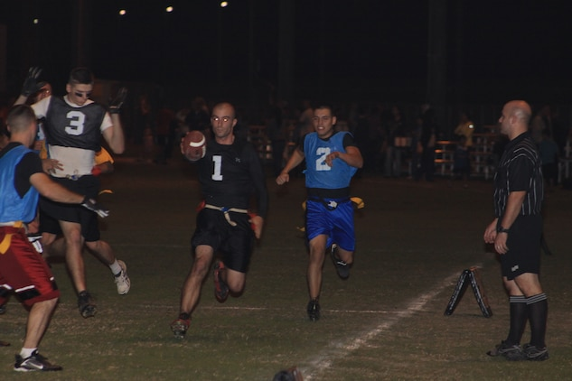 Steve Debruyn, the Ultimate Warriors quarterback, sprints with ease for a touchdown during the Ultimate Warriors vs. Bloodbath and Beyond 2010 Intramural Flag Football game at Penny Lake field here Oct. 20. The Ultimate Warriors played tough defense, made sustained drives and completed passes, which landed them a 26 - 14 victory over Bloodbath and Beyond.