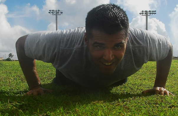 Staff Sgt. Louis Almaguer completes a correct push-up by lowering his body to the ground and making sure his elbows are bent at least 90 degrees or less before pushing back up to the starting position. The new fitness assesment allocates 60% for Aerobic (run or walk), 20% for abdominal circumference and 10% each for sit ups and pushups.  Sergeant Almaguer is  the NCO in charge of Construction Management with the 36th Civil Engineer Squadron.  (U.S. Air Force photo/Staff Sgt. Jamie Powell)
