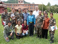 Nepalese medical personnel pose for a picture with Dr Matt Dolan during DIMO's avian/pandemic influenza course; Kathmandu, Nepal, June 2010.  (US Air Force Photo)
