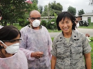 Lieutenant Colonel (Dr) Pat Ewings instructs Nepalese students how to don/doff personal protective equipment during DIMO's avian/pandemic influenza course; Kathmandu, Nepal, June 2010.  (US Air Force Photo)