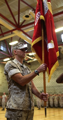 Lieutenant Col. Aaron Weiss officially receives the 3rd Low Altitude Air Defense Battalion colors during a change of command ceremony at Camp Del Mar, Oct. 19.
