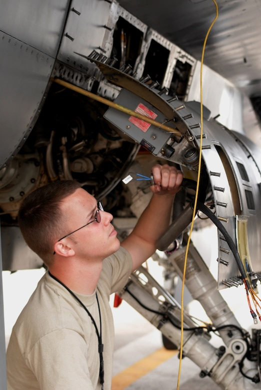 Senior Airman Bradley Baldus, 51st Aircraft Maintenance Squadron, troubleshoots an electrical system problem in an Osan F-16 Fighting Falcon Oct. 20 during exercise Max Thunder 10-2 at Kwangju Air Base, Republic of Korea. (U.S. Air Force photo/Staff Sgt. Eric Burks)