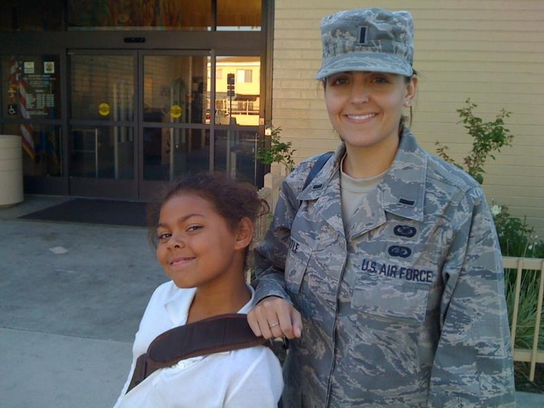 Lt. Mara Title, SMC Public Affairs, and the student that she tutors in the School on Wheels program. (Courtesy photo)