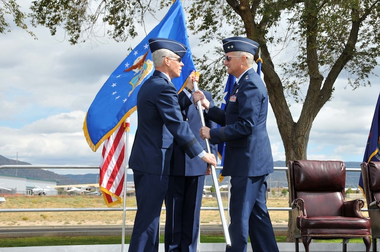 The Assistant Vice Chief of Staff of the Air Force Lt. Gen. William L. Shelton gives command of the Air Force Operational Test and Evaluation Center to Maj. Gen. David J. Eichhorn.