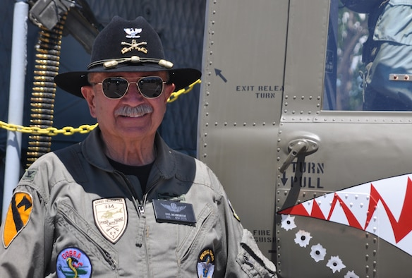 Army Col. (ret.) Bill McPherson is the honorary commander for the 34th Aeromedical Evacuation Squadron. Colonel McPherson proudly displayed and gave tours of his restored UH-1 (M) 'Huey' to 302nd Airlift Wing families during the wing's Family Day at Peterson Air Force Base on Saturday of the August Unit Training Assembly. (U.S. Air Force photo/Ann Skarban)