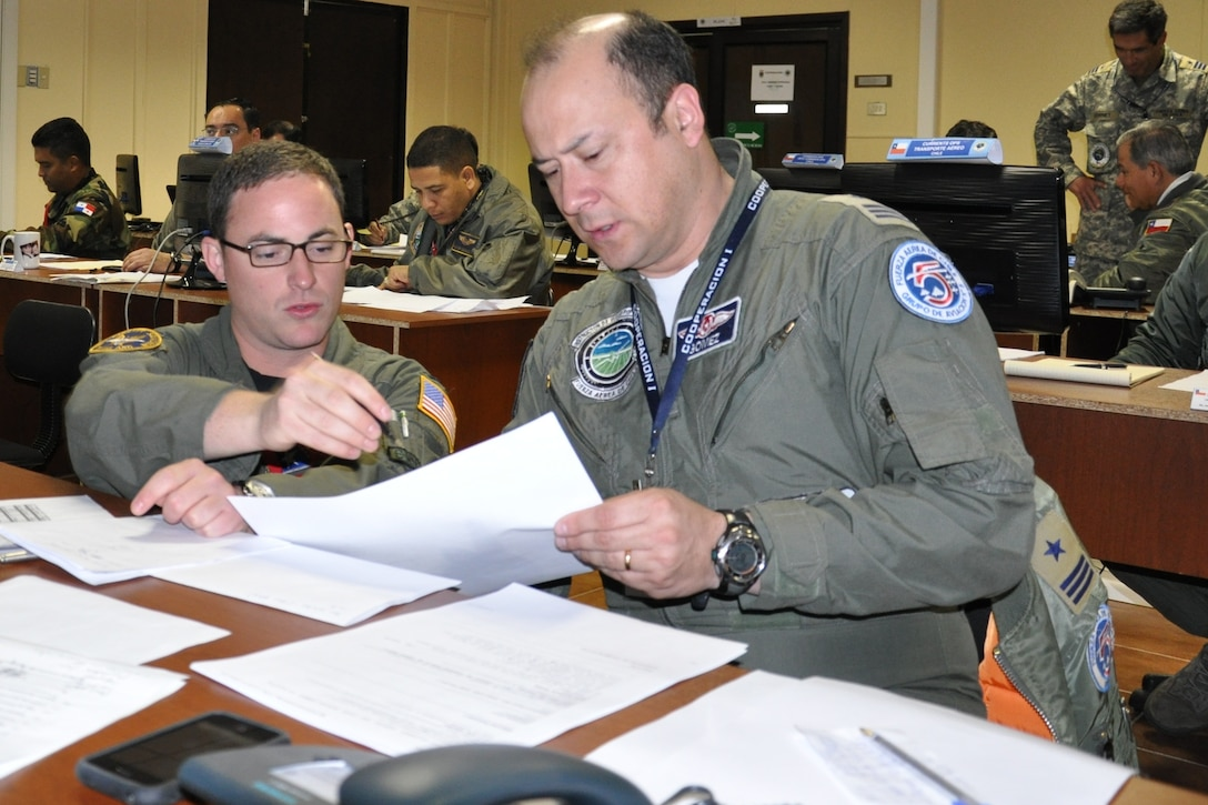 1st. Lt. William Holland, a pilot with the 136th Airlift Wing, Texas Air National Guard, coordinates U.S. air support and the movement of cargo in a Combined Air Operations Center created specifically for a SICOFAA exercise, (Sistema de cooperacion de las Fuerzas Aerias de las Americas) Cooperation 1 headquartered in Puerto Montt, Chile, Oct. 4 to 14. The exercise scenario involved using the air forces of SICOFAA member nations for humanitarian assistance after a natural disaster (U.S. Air Force photo/Capt. Rebecca A. Garcia).