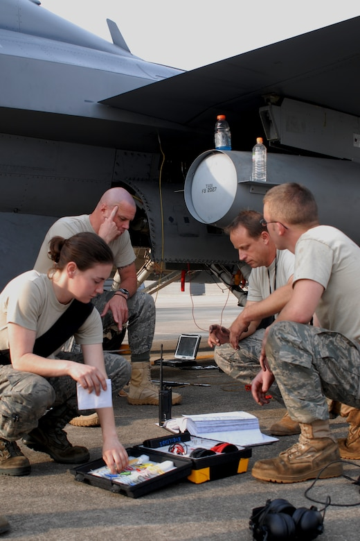 (Left to right) Senior Airman Denise Russell, 36th Aircraft Maintenance Unit, Master Sgt. Warren McCullough, 36th AMU, Maj. Daniel Mattioda, 8th Maintenance Squadron, and Senior Airman Bradley Baldus, 36th AMU, brainstorm while troubleshooting an electrical system problem in an Osan F-16 Fighting Falcon Oct. 20 during exercise Max Thunder 10-2 at Kwangju Air Base, Republic of Korea. (U.S. Air Force photo/Staff Sgt. Eric Burks)