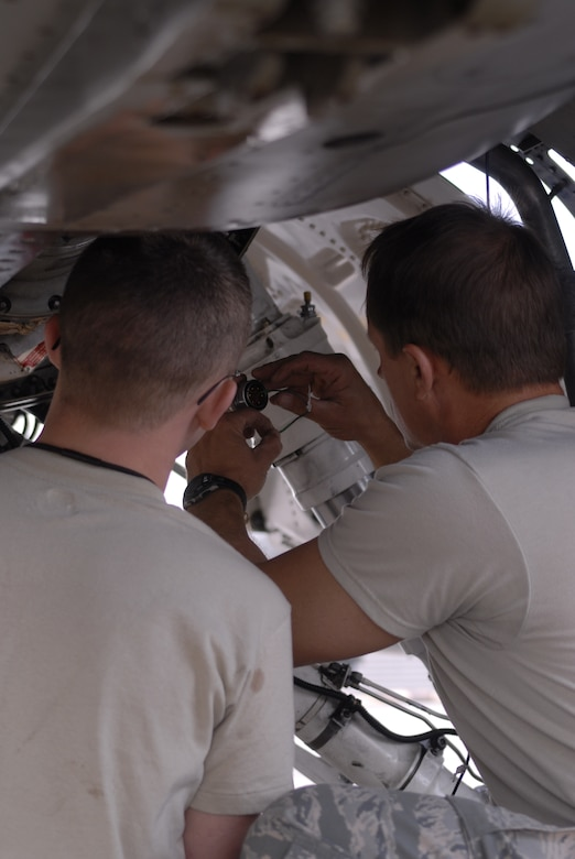 Maj. Daniel Mattioda, 8th Maintenance Squadron, right, and Senior Airman Bradley Baldus, 51st Aircraft Maintenance Squadron, troubleshoot an electrical system problem in an Osan F-16 Fighting Falcon Oct. 20 during exercise Max Thunder 10-2 at Kwangju Air Base, Republic of Korea. Major Mattioda is prior-enlisted with an electrical environmental background. (U.S. Air Force photo/Staff Sgt. Eric Burks)
