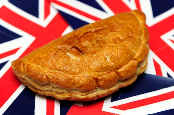 A Cornish pasty is a short-crust pastry case with a filling. It's a little different from a regular pie as it's made by placing the filling on a circle of pastry, folding the case over to wrap up the filling and crimping the edge to seal it, so you end up with a semicircular parcel of scrumptiousness. The traditional pasty is filled with beef, sliced potato, turnip or swede and onion, and then baked. In a proper pasty, the filling ingredients must never be cooked before they are wrapped in the pastry casing. (U.S. Air Force photo by Airman 1st Class Lausanne Morgan)