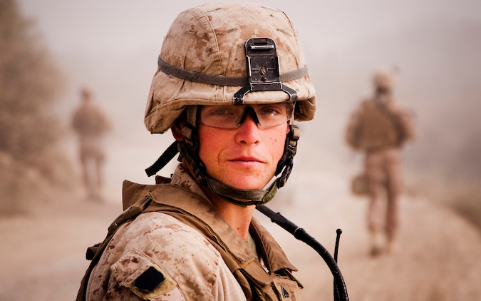 Cpl. Brandon Owensby, a radio operator with Jump Platoon, 3rd Battalion, 3rd Marine Regiment, looks back during a patrol while escorting media through the Nawa Bazaar in Helmand province, Afghanistan, Oct. 22, 2010. Jump Platoon's primary mission is to provide security for the battalion commander and transport him throughout 3/3's battle space, but the platoon performs a variety of tasks from providing supplementary security and running vehicle checkpoints, to masonry and gardening. (Official Marine Corps photo by Sgt. Mark Fayloga)