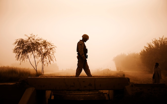 Chief Warrant Officer 2 James Law, the Jump Platoon commander and battalion gunner for 3rd Battalion, 3rd Marine Regiment, walks across a bridge in Nawa, Helmand province, Afghanistan, while providing security during a media escort Oct. 22, 2010. Jump Platoon's primary mission is to provide security for the battalion commander and transport him throughout 3/3's battle space, but the platoon performs a variety of tasks from providing supplementary security and running vehicle checkpoints, to masonry and gardening. Law is from Portland, Ore.