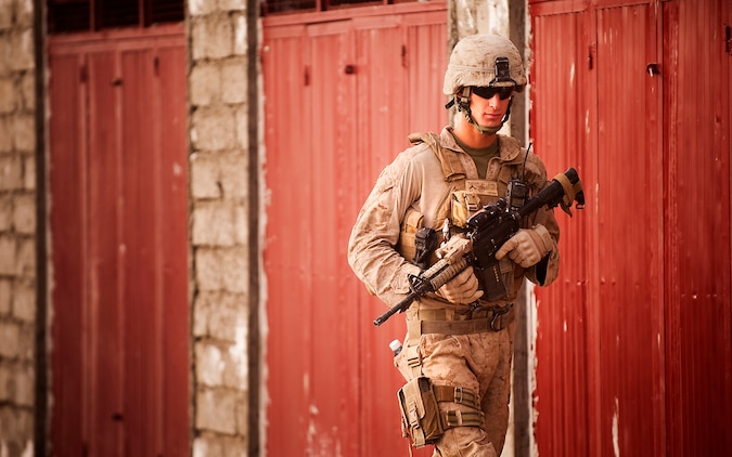 Pfc. Steven L. Blizzard, a driver with Jump Platoon, 3rd Battalion, 3rd Marine Regiment, provides security while escorting media through the Nawa Bazaar in Helmand province, Afghanistan, Oct. 22, 2010. Jump Platoon's primary mission is to provide security for the battalion commander and transport him throughout 3/3's battle space, but the platoon performs a variety of tasks from providing supplementary security and running vehicle checkpoints, to masonry and gardening. Blizzard is from Clare, Mich.