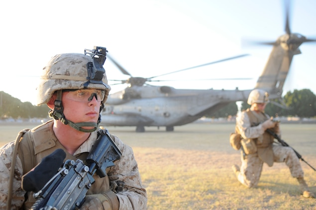 Cpl. Zachary Givens, left, squad leader, waits for orders from 2nd Lt. Luis Spradley, platoon commander with E Company, 2nd Battalion, 7th Marine Regiment, at Kiwanis Park in Yuma Ariz., Oct. 22, 2010. Both Marines are stationed at the Marine Corps Air Ground Combat Center Twentynine Palms, Calif.
