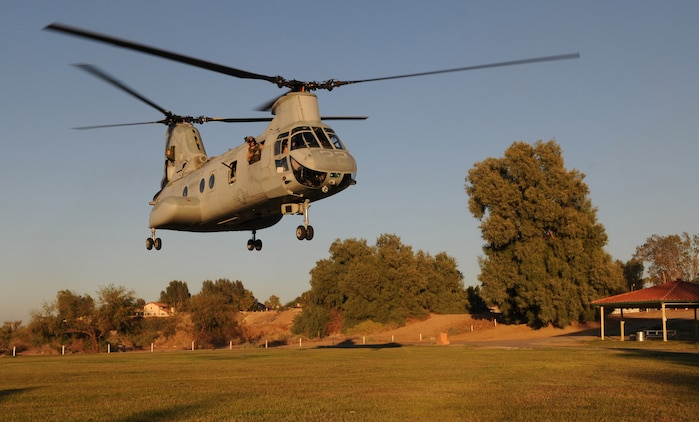 Shortly after dropping off Marines from E Company, 2nd Battalion, 7th Marine Regiment, a CH-46 Sea Knight departs from Pat Williams Park in Brawley, Calif., Oct. 22, 2010. As part of the Weapons and Tactics Instructor course taught at Marine Corps Air Station Yuma, Ariz., different aircrafts transported Marines for the noncombatant evacuation operation, which simulates extracting American citizens from an American embassy in hostile territory.