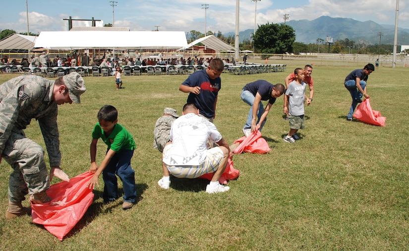 SOTO CANO AIR BASE, Honduras --  Quickly jumping in their bags, U.S. servicemembers, foreign service nationals and their family members participate in a sack race during FSN Family Day here Oct. 22. Besides a base tour, FSNs were awarded for their service to Soto Cano during the festivities. (U.S. Air Force photo/Capt. John Stamm)