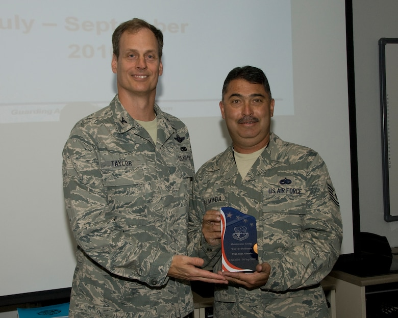10/15/2010 – TUCSON, Ariz. -- Col. James Taylor, (Left) recognizes TSgt. Jesus Almada as the 162nd Maintenance Group Elite Performer for this quarter. The ceremony took place Oct 15. (Air Force photo by Master Sgt. David Neve)