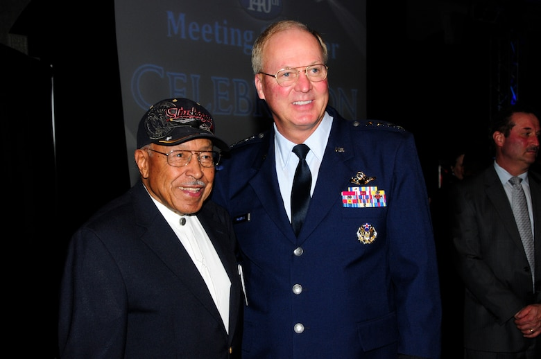 General Craig McKinley, chief of the National Guard Bureau, and former Tuskegee Airman and Pilot, Major Joe Gomer, pose for a photo together while at the annual Chamber of Commerce Dinner and Gala held on Oct. 21, 2010 at the Duluth Entertainment and Convention Center in Duluth, Minn.  Gen. McKinley was the keynote speaker for the event and spoke highly of 148th accomplishments, and the communities' positive support of military members.  He also recognized Maj. Joseph Gomer, a Duluth resident in attendance who served as a fighter pilot with World War II's famed Tuskegee Airmen.    (U.S. Air Force photo by MSgt Ralph Kapustka)