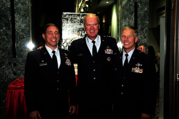General Craig McKinley, chief of the National Guard Bureau, poses for a photo with former 148th Fighter Wing Commander and current Assistant Adjutant General - Air, Bridagadier Gen. Timothy Cossalter, and current 148th FW Commander, Colonel Frank Stokes at the annual Chamber of Commerce Dinner and Gala held on Oct. 21, 2010 at the Duluth Entertainment and Convention Center in Duluth, Minn.  Gen. McKinley was the keynote speaker for the event and spoke highly of 148th accomplishments and the communities' positive support of military members.    (U.S. Air Force photo by MSgt Ralph Kapustka)