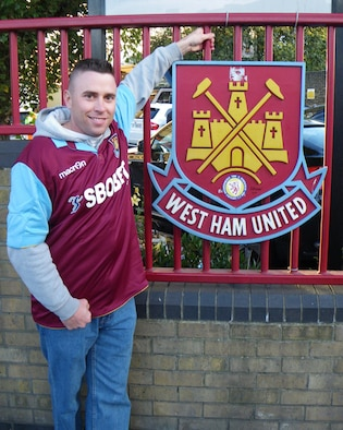 Tech. Sgt. Kevin Wallace, 100th Air Refueling Wing public affairs, stands at the gate of Boleyn Ground in Upton Park, London, home to the West Ham United Football Club Oct 24, 2010. It was the American servicemember's first English soccer game. (U.S. Air Force photo/Danny Reed)