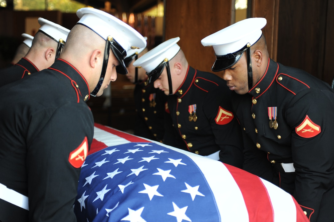 Marine Corps Body Bearers carry the body of Maj. Gen. Warren R. Johnson Sr. inside the Memorial Chapel at Fort Meyer Oct. 26. Johnson, who was a retired artillery officer, was buried in Arlington National Cemetery. (Photo by Cpl. Bobby J. Yarbrough)