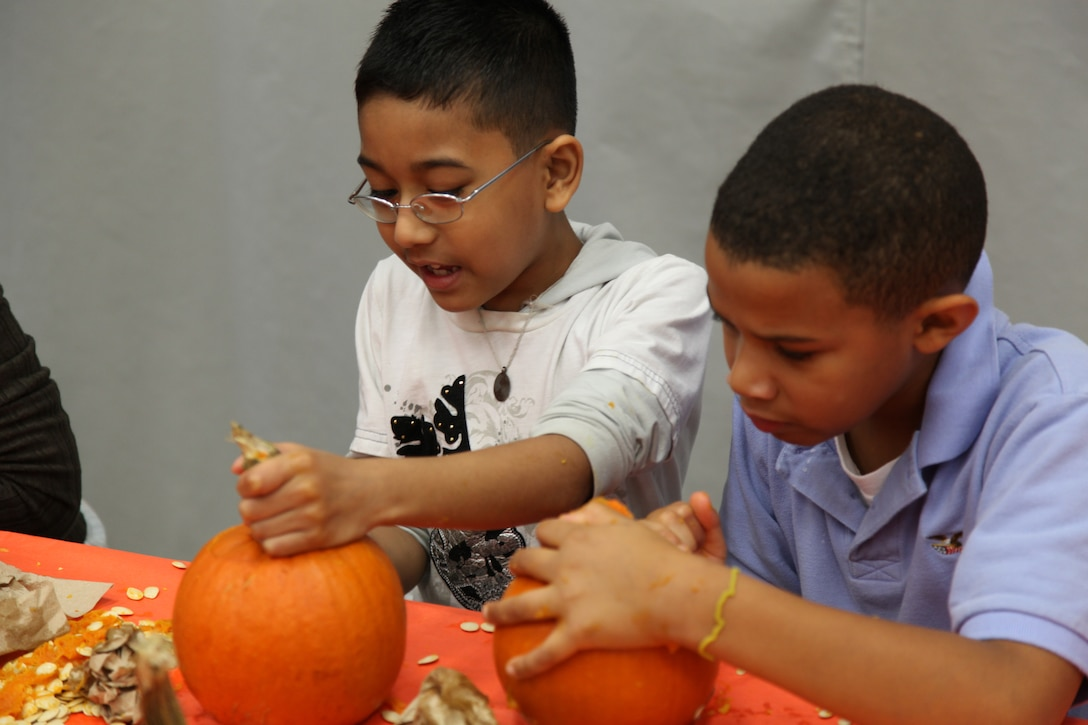 Sowrav Barua, a third grader at Barcroft Elementary School in Arlington, Va., carves his pumpkin with the Tutors and Buddies program Oct. 26, 2010. Traditionally, the tutors and buddies go into the school around Halloween to carve pumpkins with the third graders, but this year the fifth graders joined in on the fun.