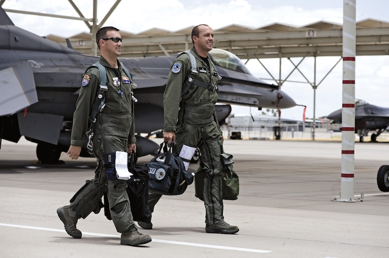 Lt. Col. Chuck Blank, left, and Maj. Pawell Marcinkowski walk to their jets before a training mission. Lt. Col. Blank is the director of operations and an instructor with the 152nd Fighter Squadron and Maj. Marcinkowski is a Polish air force student in Instructor pilot upgrade training. After graduation, Major  Marcinkowski will return to Poland and train pilots there. (U.S. Air Force photo/ Master Sgt. Jack Braden)