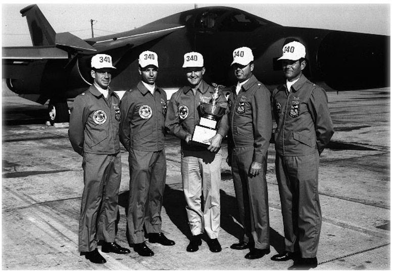 MCCOY AIR FORCE BASE, Fla. - The 17th Bombing and Navigation Competition saw the first appearance of FB-111s; the re-appearance of tanker squadrons; criteria for the Fairchild and Saunders Trophies was changed; and the Mathis Trophy was awarded for the first time. The best bombing honors went to the 340th Bomb Group's, from Carswell Air Force Base, Texas. The Carswell AFB unit placed second for the Mathis Trophy, awarded to the top bomber unit based on combined results in bombing and navigation, and second for the Navigation Trophy. Accepting the trophy in 1970 are (left to right) Lt. Col. R. S. Russell; Maj. A. R. Ely; Col. K. J. Green, 340th BG commander; Lt. Col. J. S. Lothar and Maj. B. R. Seals. (Courtesy photo)