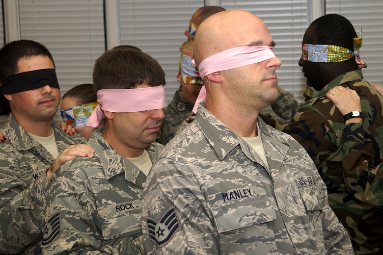 """McENTIRE JOINT NATIONAL GUARD BASE, S.C. - NCOs from the 169th Fighter Wing here participate in a """"Blind Trust Walk"""" during a leadership development course held at Fort Jackson, Oct. 2-3, 2010.  (U.S. Air Force photo by Tech. Sgt. Stephen Hudson/Released)"""